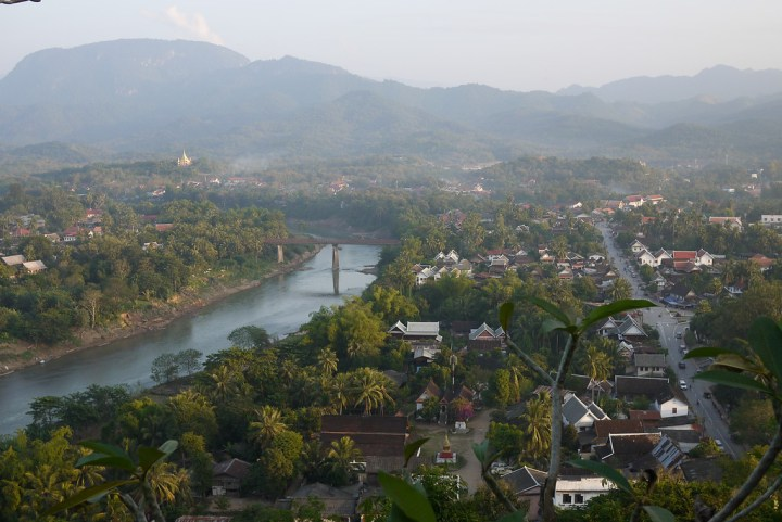 The sprawling city and countryside around the heart of Luang Prabang, Laos at sunset from Mount Phousi.