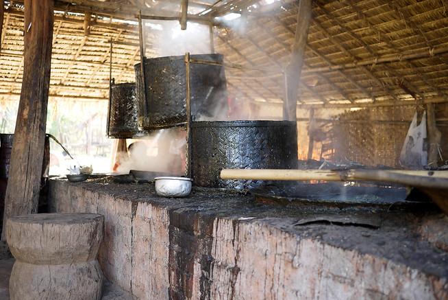 Boiling sugarcane into candy, Burma