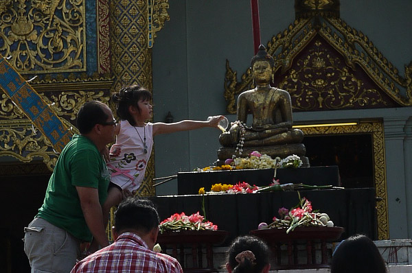 Ritual bathing of the Buddha at Wat Phra Singh for Songkran in Chiang Mai, Thailand