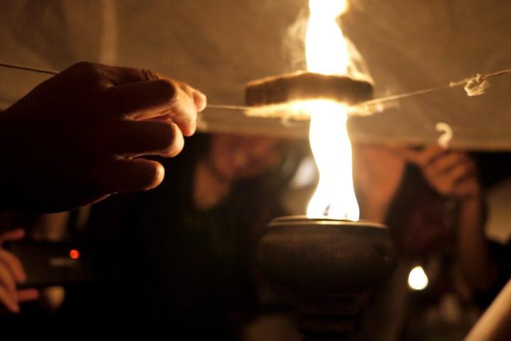 lighting a khom loi lantern