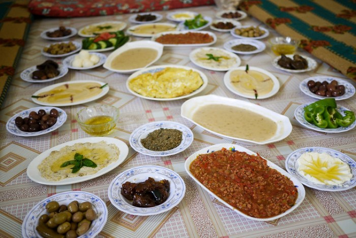 A jordanian meal laid out family style and ready for the sampling.