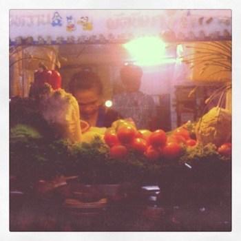 Street food stand with fresh veggies in Bangkok, Thailand