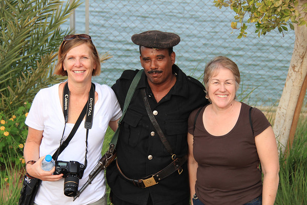 Egyptian guard and tourists