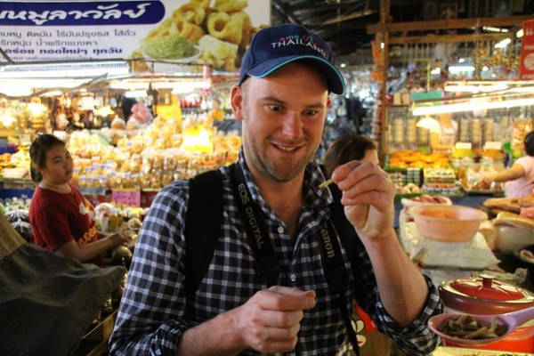 eating a bamboo worm in Northern Thailand