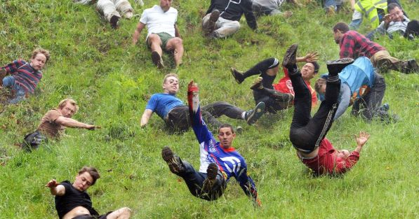 Chris-Anderson-centre-wins-the-first-race-during-the-annual-unofficial-cheese-rolling-at-Coopers-Hill-in-Brockworth