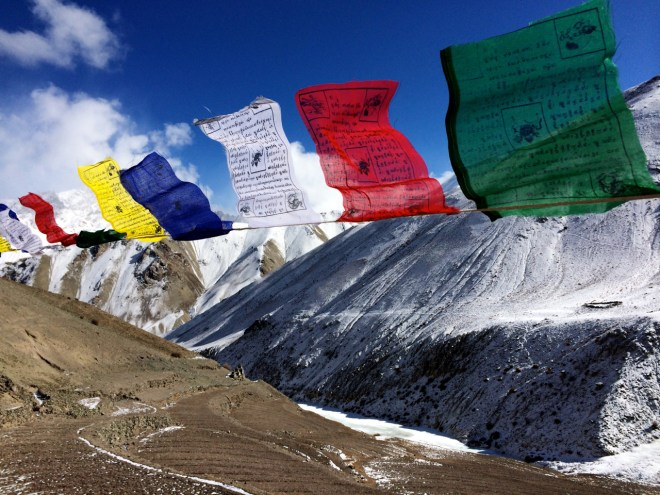 Prayer flags fluttering as my heart did too in that surreal landscape