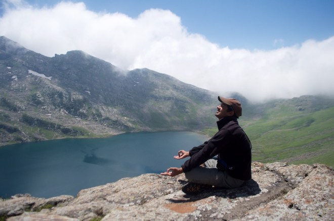 Jaichand, does a classic yoga pose with Marsar Lake in the background