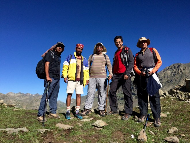 A group photograph at the highest point of the trek