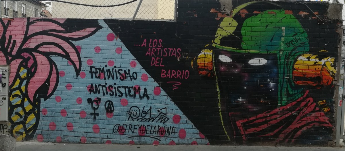 "Graffiti on Calle de Los Embajadores in Madrid, with extracts of text reading ""antisystemic feminism"" and ""to the artists of the neighbourhood"""