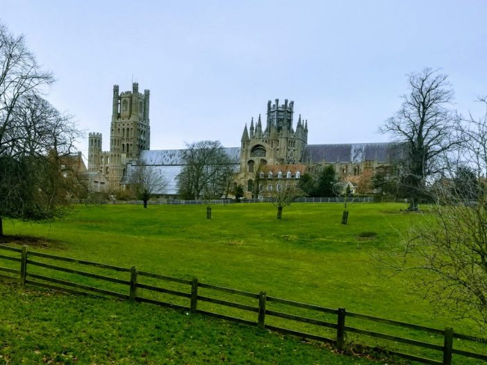 A view of Ely Cathedral across the fields of Cherry Hill Park