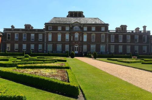 A view of the back of Wimpole Hall and the gardens.
