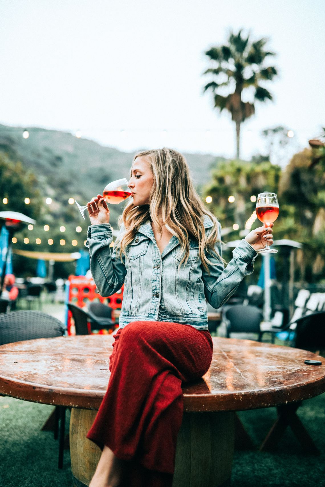 A picture of a woman holding two glasses of wine