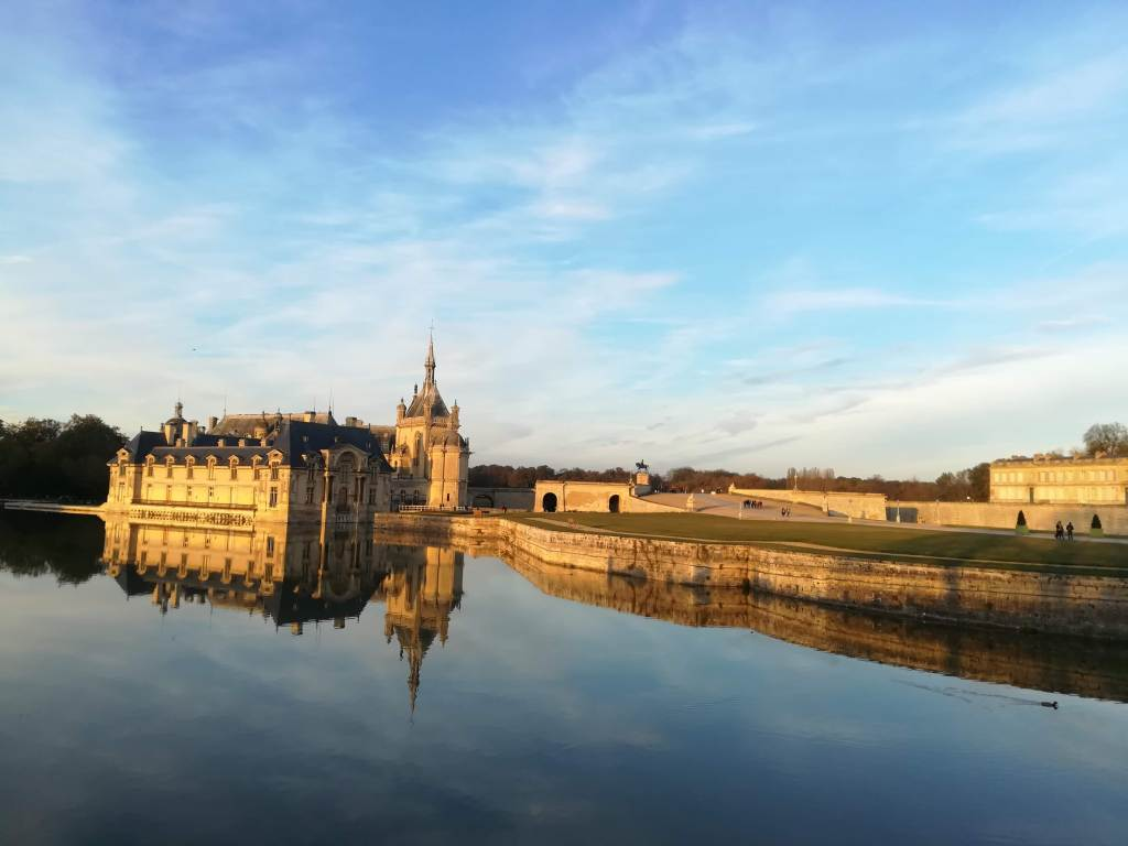 Chantilly castle reflected in the lake. Paris