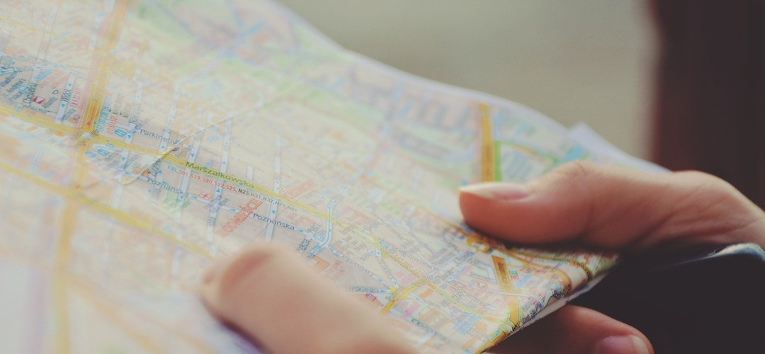 Hands holding a road map