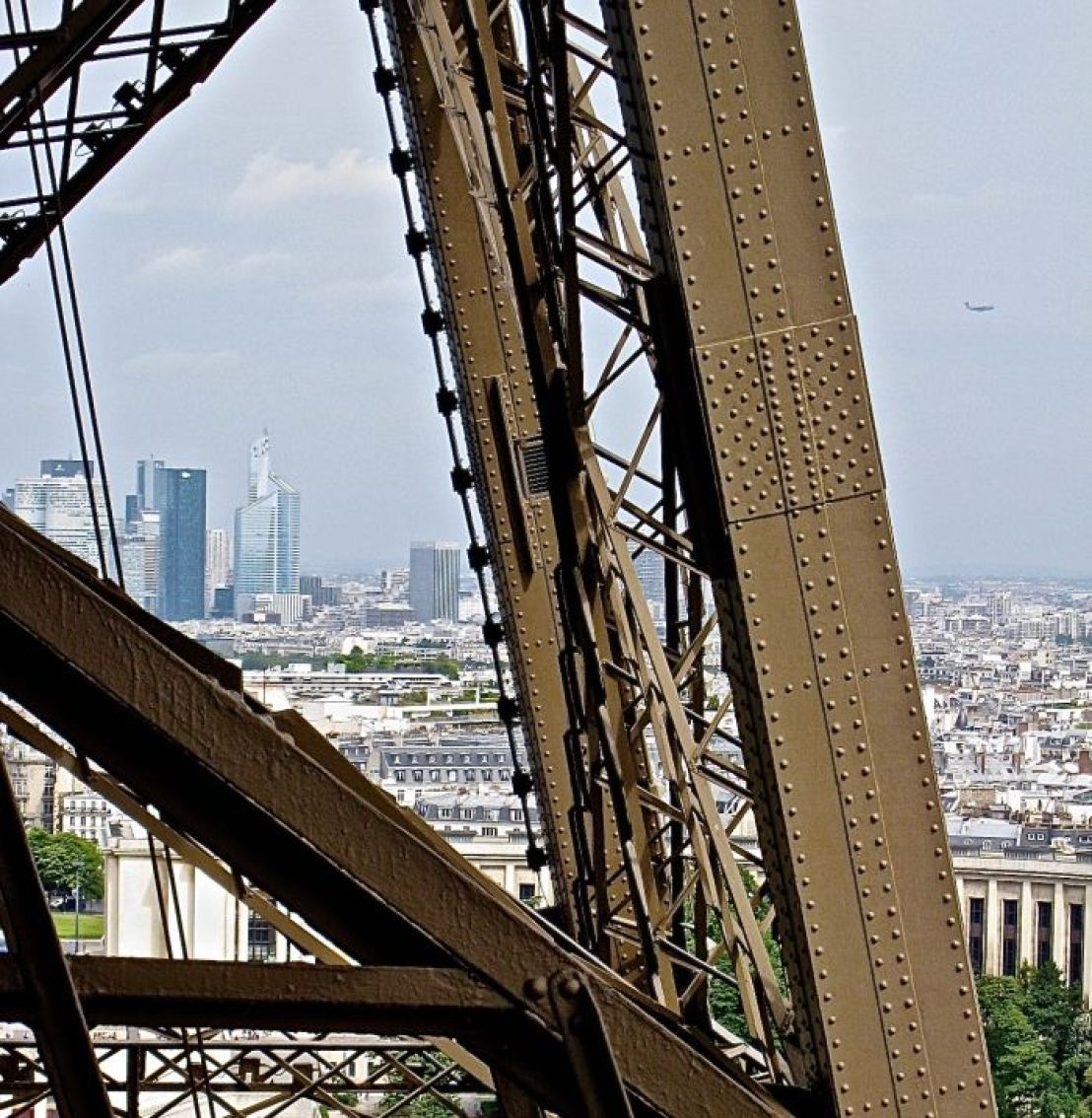 View of the city and approaching plane from the Eiffel Tower