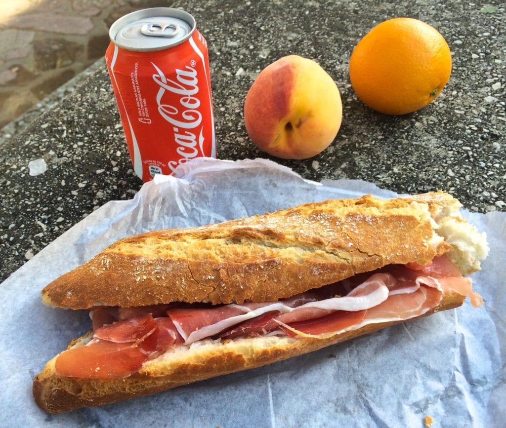 A picnic with a deli sandwich