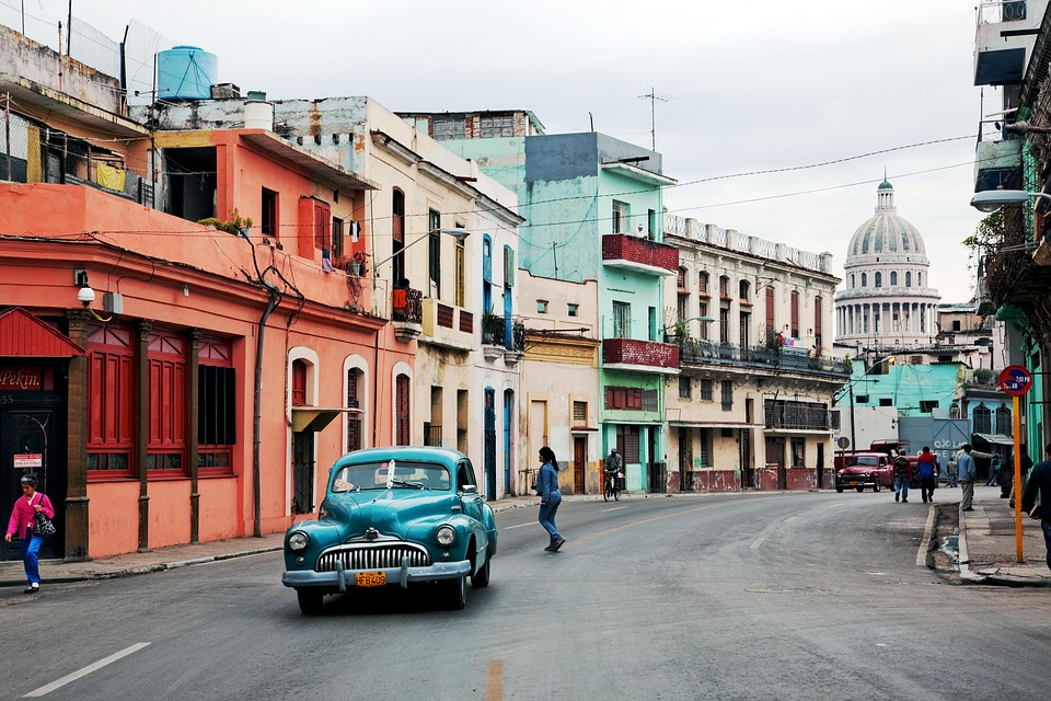 Cuba-pastel buildings and car