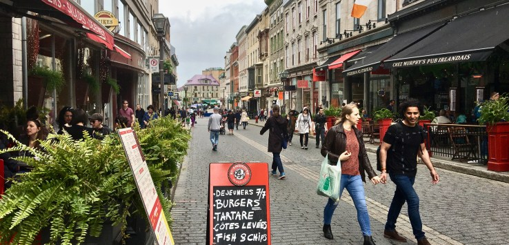 Quebec City: Cobbled pedestrian streets are lined with cages and restaurants. (Photo by Suzanne Ball. All rights reserved.)