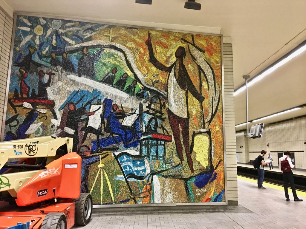 Metro Subway: Look for art and special themes at different stops. Here, a mosaic shows an orchestra and the Quebec flag. (Photo by Suzanne Ball. All rights reserved.)