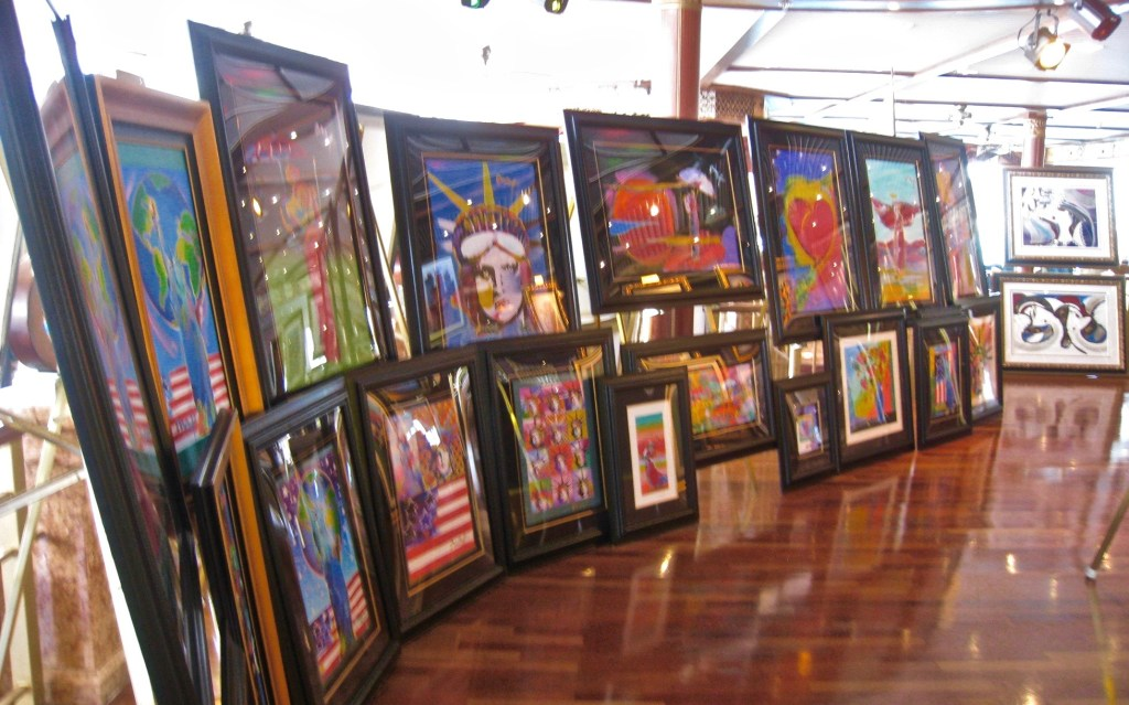 """Disadvantages of cruises: There is no escaping the relentless art sales and auctions. Lured by champagne, passengers are a captive audience for the daily art """"deals."""""""