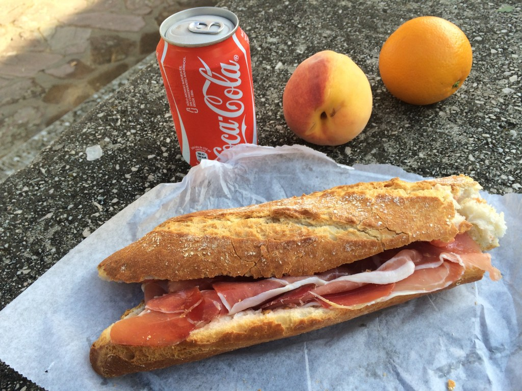 Delicious-and fun reasons to walk the Camino de Santiago: The BEST sandwiches you will ever have! Witness the Serrano ham on a crusty loaf. What you can't see: the tomato rubbed into the bread, then soaked with olive oil. Cost: 4 Euros