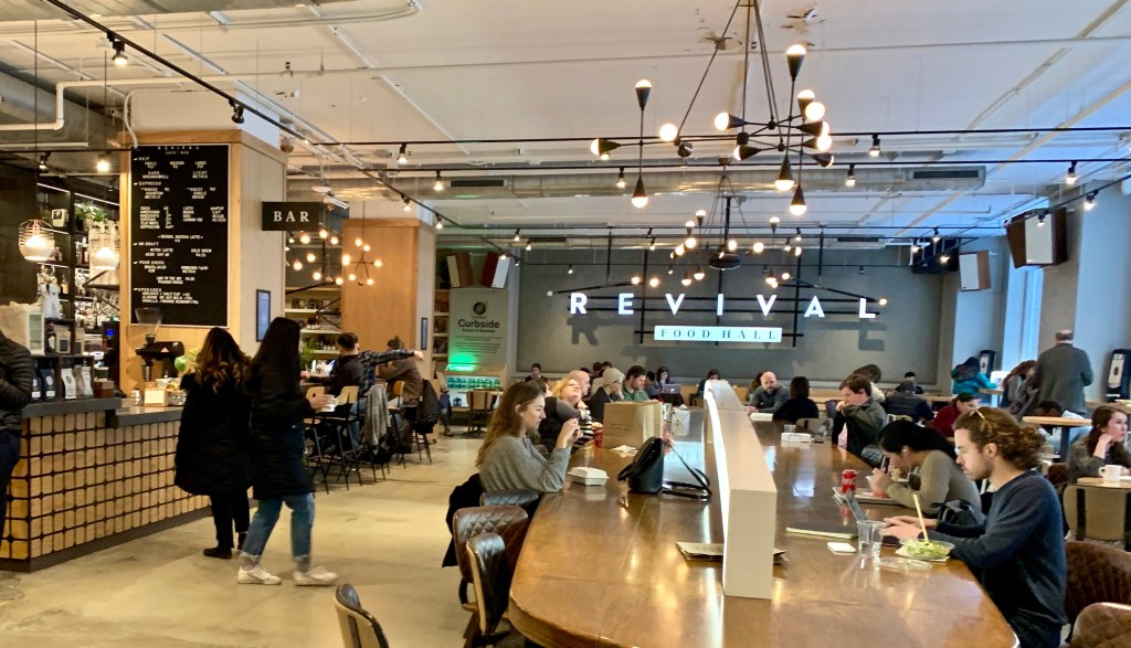 Revival Food Hall is a hip space, with food stalls, a bar, and spots to work or hang out.