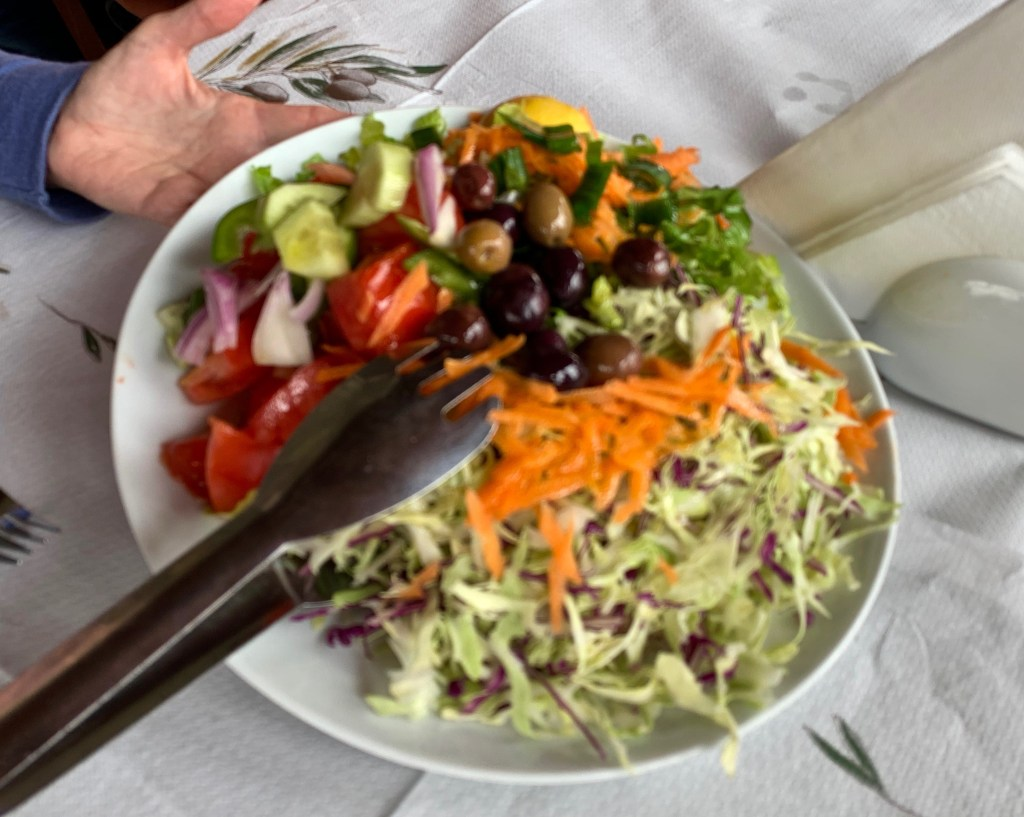 Greek Cole slaw is simple: carrots and cabbage, with a splash of olive oil...GOOD olive oil, of course!