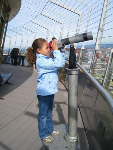 "Saedy ""scopes"" out the view from the Seattle Space Needle observation deck. (Photo by Suzanne Ball)"