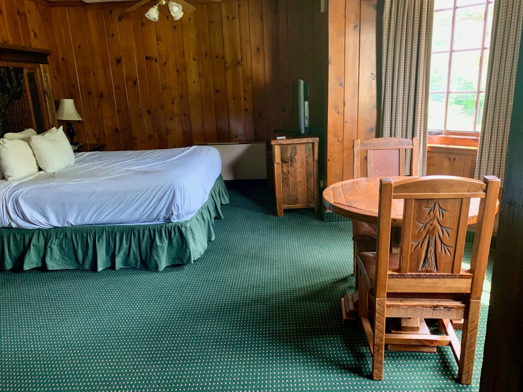 Room at Starved Rock Lodge, with wood paneling and hand-carved furniture.