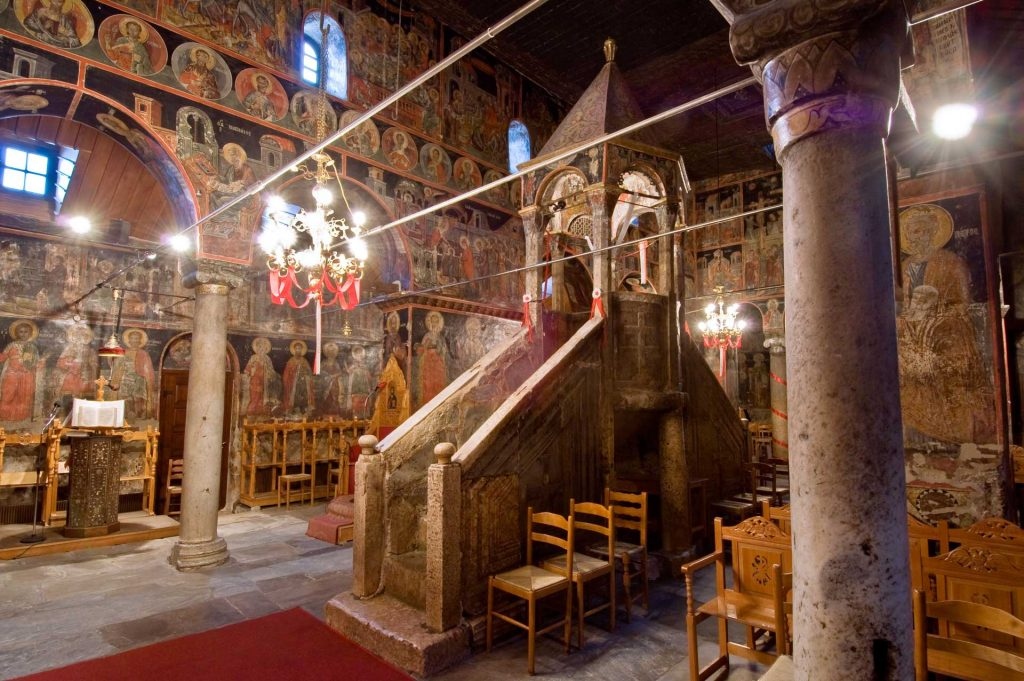 A postcard shows the interior of the church and its marble pulpit. One of the things to do in Meteora Greece!