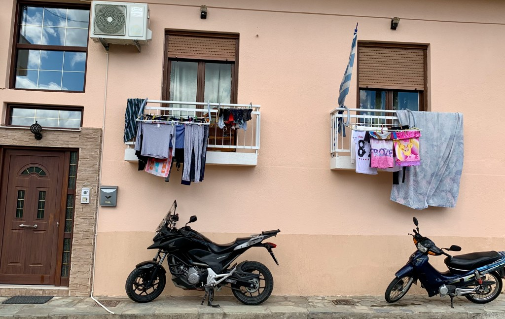Meteora, Greece is a great place to wander. Clotheslines and motorcycles tell us about daily life.