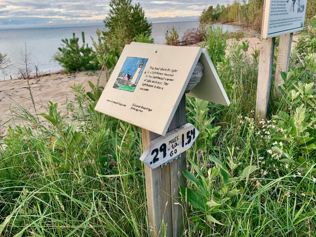 Interpretive signs on the boardwalk helped my solo road trip to Manistique, MI be educational, too