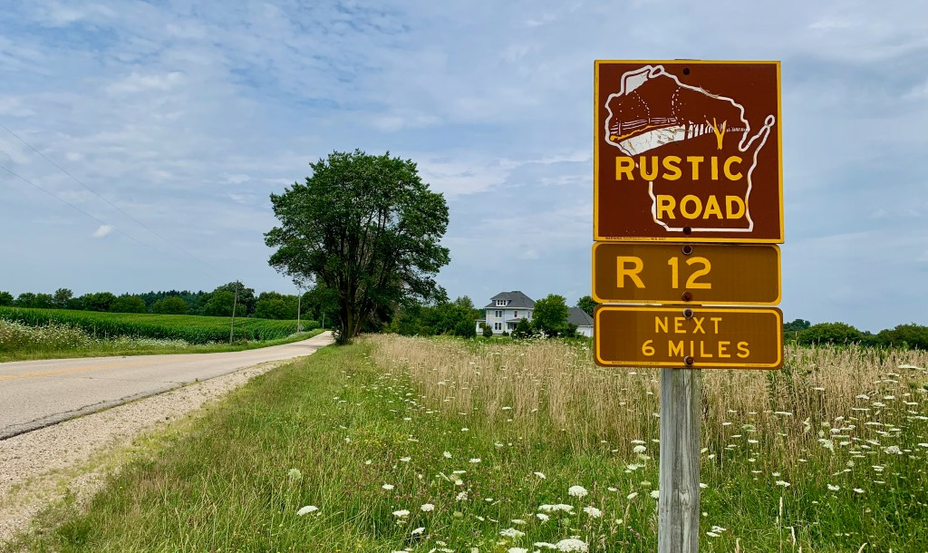 Brown and yellow signs mark the Wisconsin Rustic Roads.