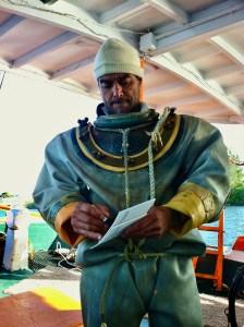 Sponge diver in a skafandro, the heavy underwater suit.