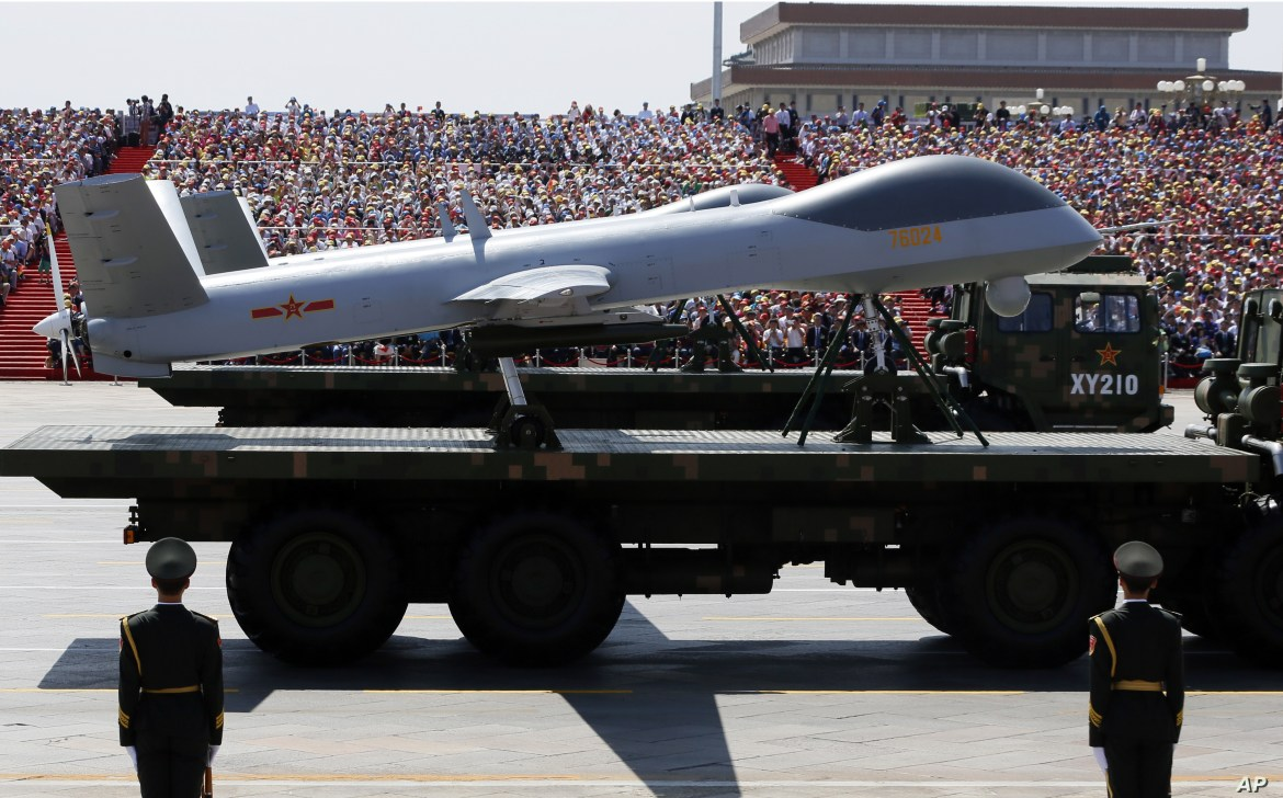 Military vehicles carry Wing Loong drones, a Chinese-made medium-altitude long-endurance unmanned aerial vehicle, past spectators during a parade commemorating at Tiananmen Gate in Beijing, China, Sept. 3, 2015.