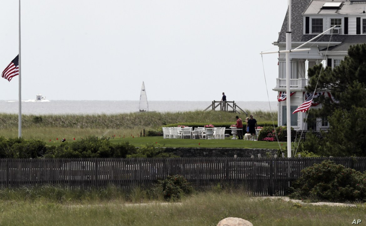 American flags flies at half staff as people gather at the Kennedy compound on Friday, Aug. 2, 2019, in Hyannis Port, Mass. Saoirse Kennedy Hill, granddaughter of Ethel Kennedy and her late husband Robert F. Kennedy, died at the compound Thursday…