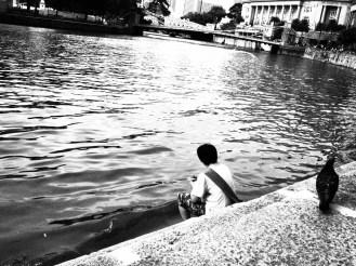 A lone fisherman at Boat Quay
