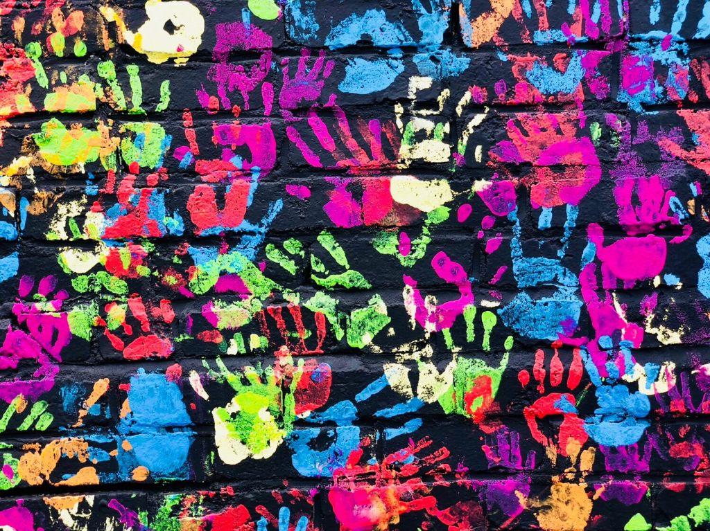 Tulsa Murals. Bright blue, pink and green handprints