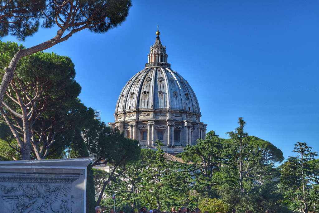 Dome of Basilica San Pietro over the trees. The Vatican is a must on a Rome bucket list. ©Jenna Lee