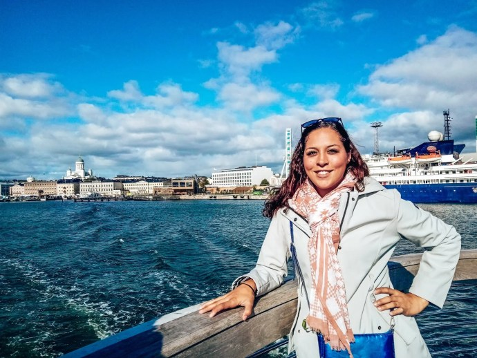 Sarah Fay on a ferry to Suemenlinna with Helsinki in the background.