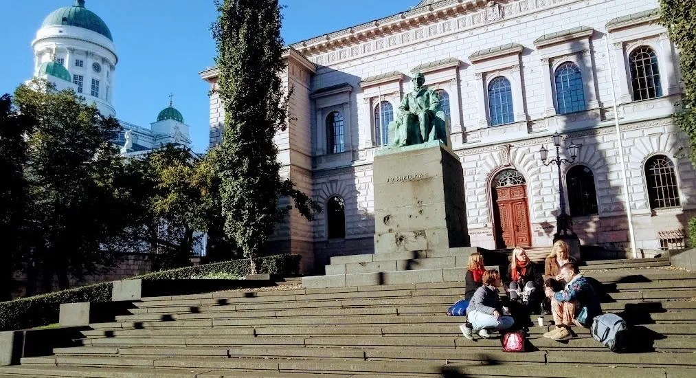 Sitting on the Steps with Helsinki Cathedral in the background.