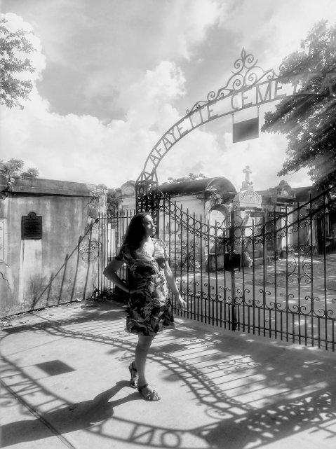 Sarah Fay staring at the Lafayette Cemetery a spooky location in New Orleans, La.