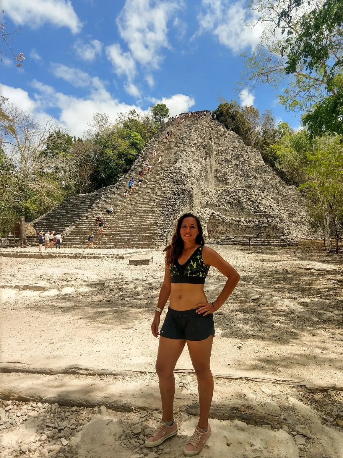 Sarah Fay travel blogger in front of Coba Ruins and Pyramid in the Jungle.