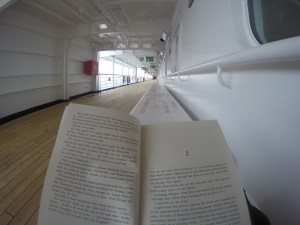 Relaxing, reading a book on P&O's Pacific Eden in the Milne Bay Province of Papua New Guinea