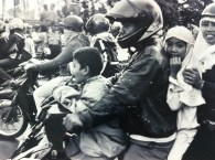 Family on a motorbike in Jakarta, Java.