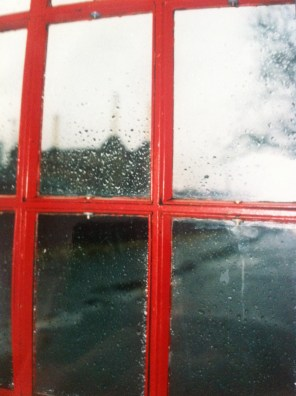 Battersea Power Station, through a red telephone box, London, England.