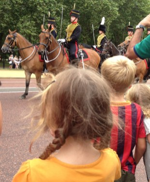 Watching the changing of the guard outside Buckingham Palace in London