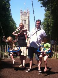 Dunnell Family at a park near the Houses of Parliament in London