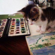 My mischievous kitten Kerouac, interrupting my painting.