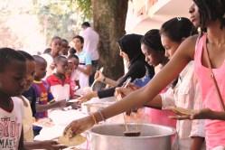 Students sharing food at Isamilo International School's Saturday School Christmas Party.
